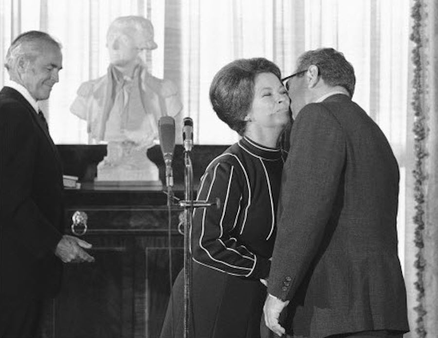 Shirley Temple Kissed By Henry Kissinger