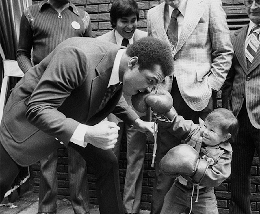 muhammad ali playing with asian child