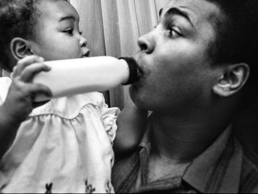 muhammad ali with baby bottle