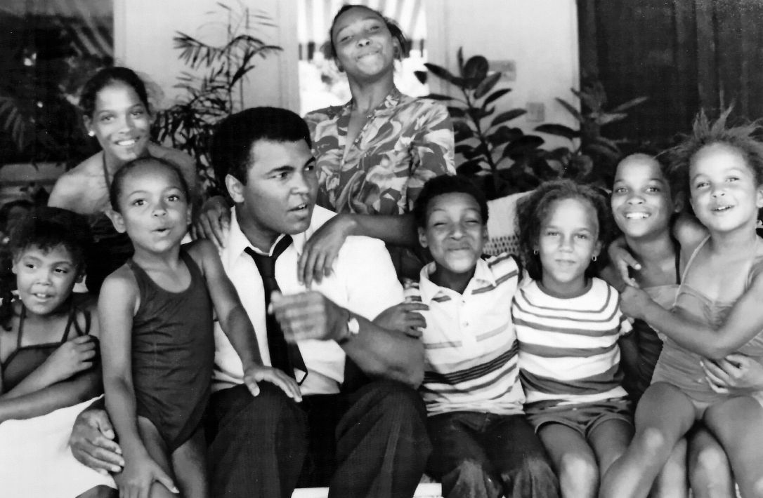 muhammad ali with several of his children